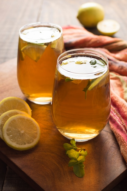 Two glass of lemon and ginger herbal tea on wooden table Free Photo