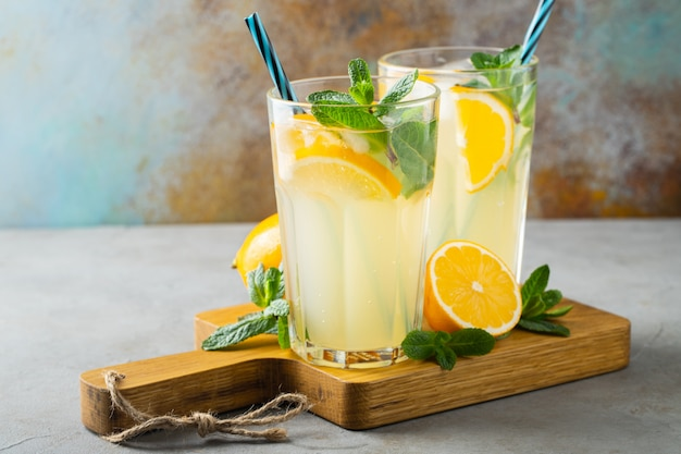 Two glass with lemonade or mojito cocktail. Premium Photo