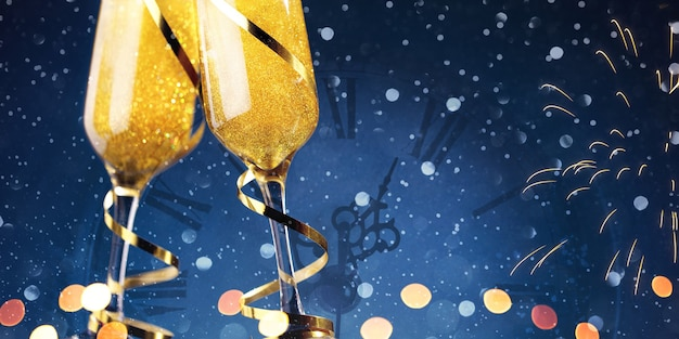 Two glasses of champagne and gold ribbons with christmas clock on blue background Premium Photo