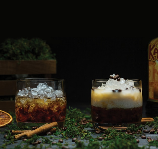 Two glasses of fine scottish whisket with ice cubes Free Photo
