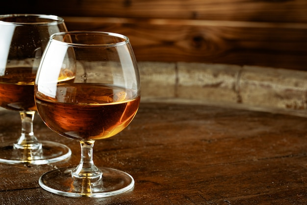Two glasses of whiskey on a wooden table in the bar Premium Photo