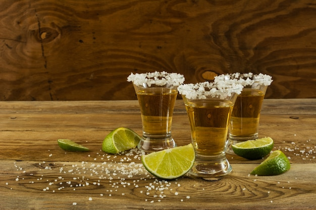 Two gold tequila shots, copy space Premium Photo