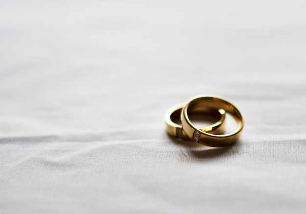 Two gold wedding ring on white background Free Photo