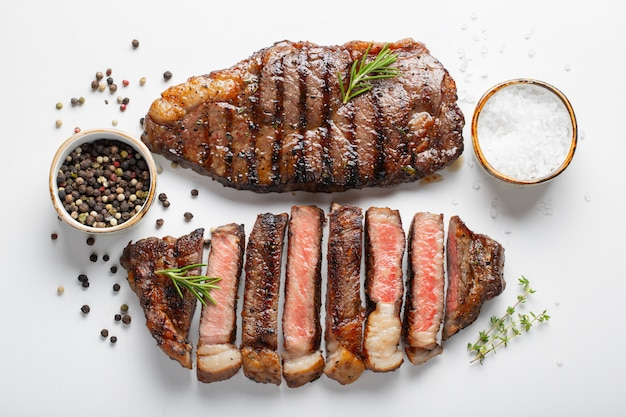 Two grilled marbled beef steaks striploin. Premium Photo