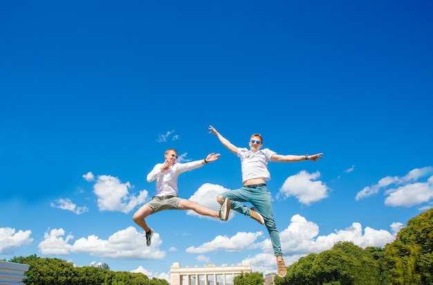 Two guys are hovering in the air Premium Photo