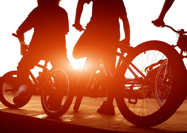 Two guys ride bicycles on a ramp for tricks Premium Photo