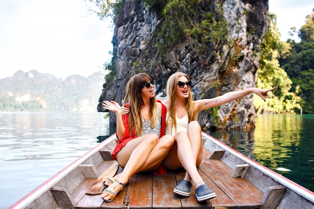 Two happy friends spending vacation in thailand khao sok mountains and lake Free Photo