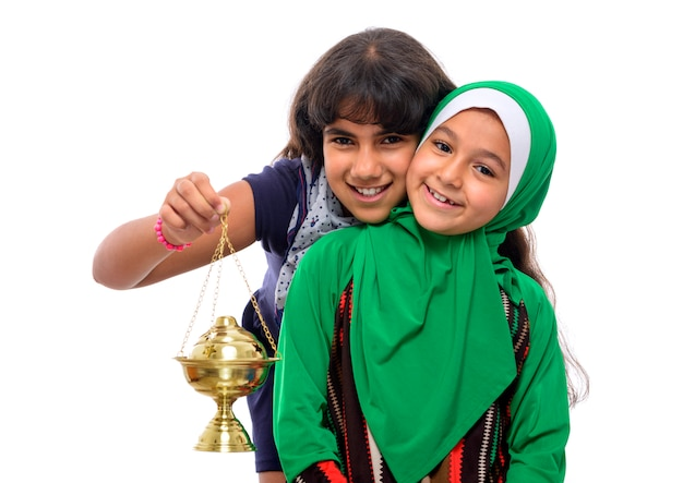 Two happy girls celebrating ramadan Premium Photo