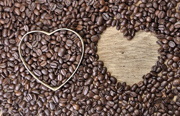 Two heart-shaped in coffee beans Premium Photo