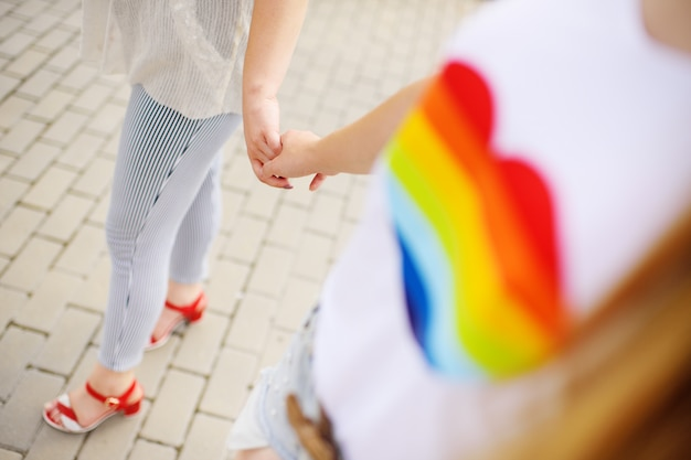 Two lesbian girls holding hands gently. Premium Photo