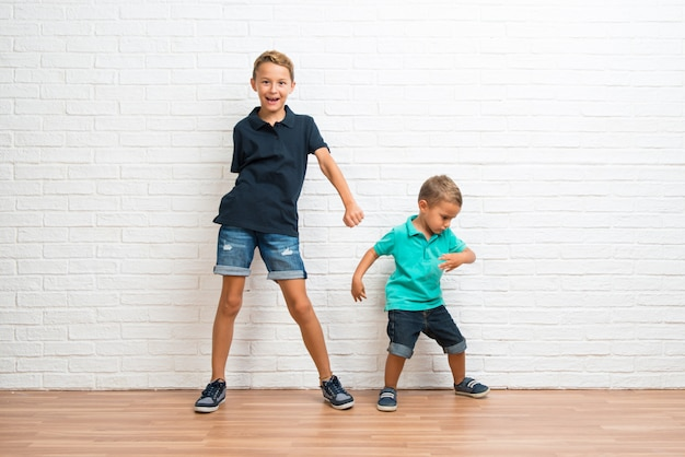 Two little brothers dancing Premium Photo