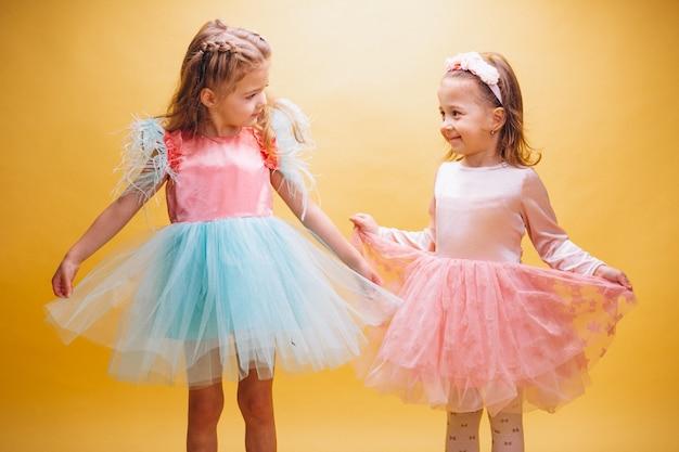Two little girls in cute dress Free Photo