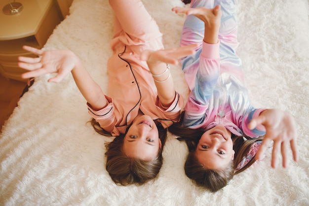 Two little girls in a cute pajamas Free Photo