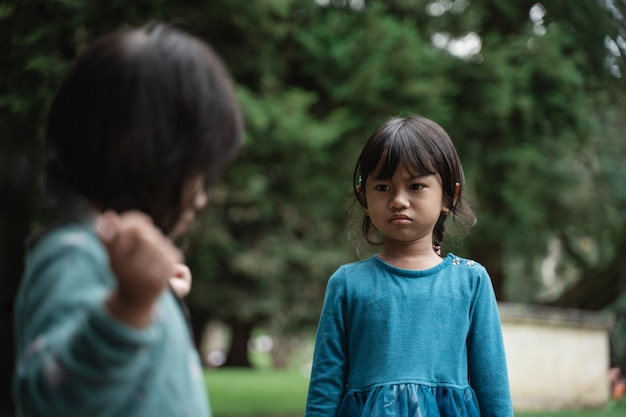 Two little girls fighting over toys Premium Photo