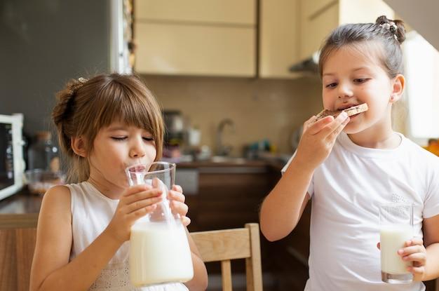 Two little girls having breakfast Free Photo