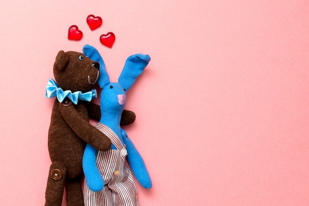 Two lovers on a bright pink background Premium Photo
