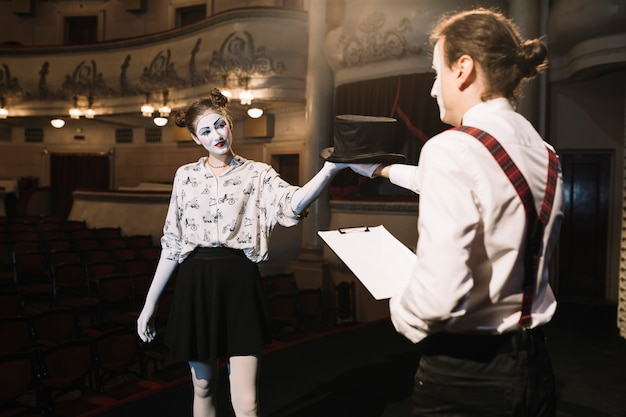Two male and female mime artist rehearsing on stage Free Photo