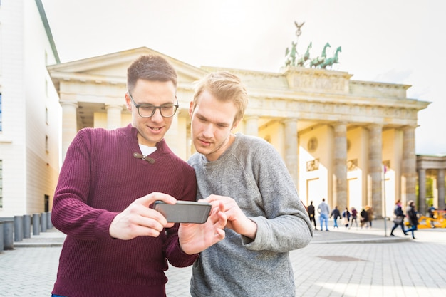 Two men looking at a smartphone in berlin Premium Photo