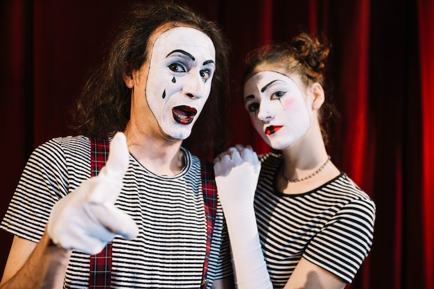 Two mime artist with hand gesture Free Photo