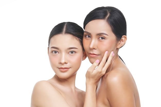 Two models beauty portrait of female face with natural skin. Premium Photo