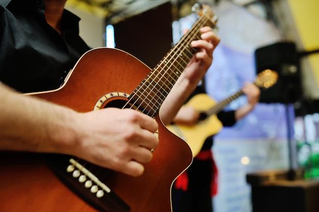 Two musicians playing guitars Premium Photo