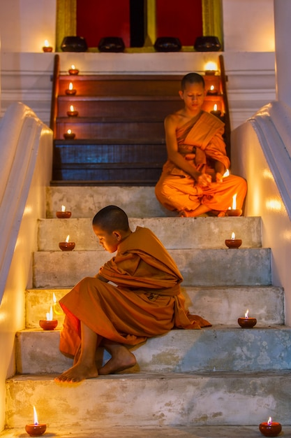 Two novices at ayutthaya historical park in thailand Premium Photo