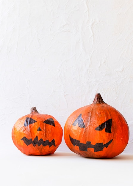 Two paper jack-o-lanterns on table Free Photo