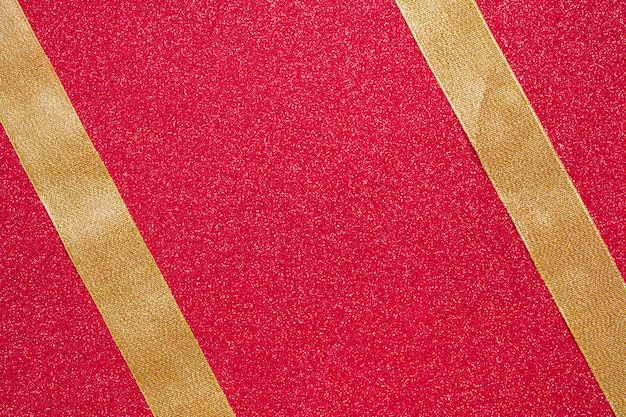 Two parallel ribbons on red background Free Photo