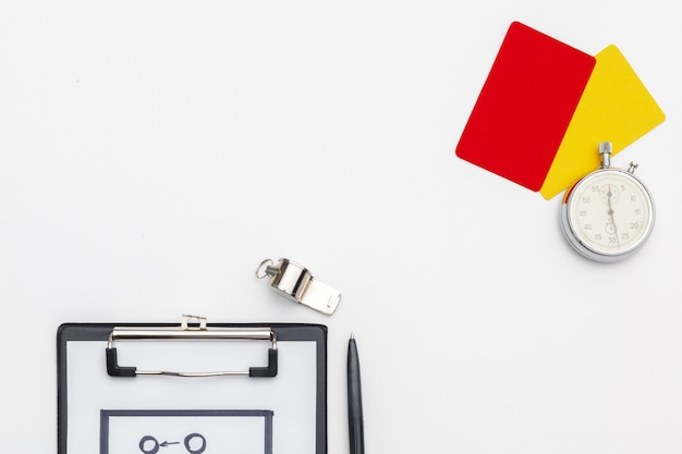 Two penalty cards and a whistle for the referee Premium Photo