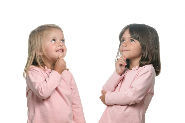 Two pensive little girls thinking about something Premium Photo