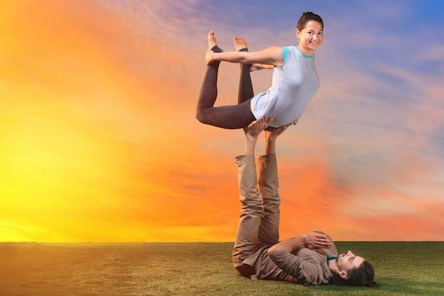 Two people doing yoga exercises Free Photo