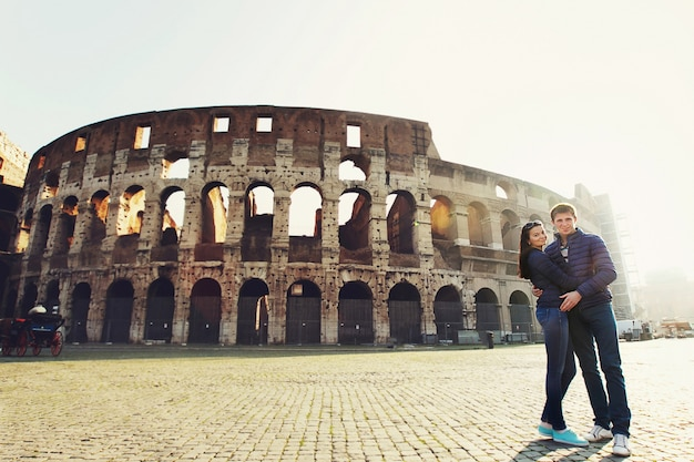 Two people standing near Coliseum in Rome Free Photo