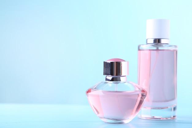 Two perfume bottles on blue Premium Photo