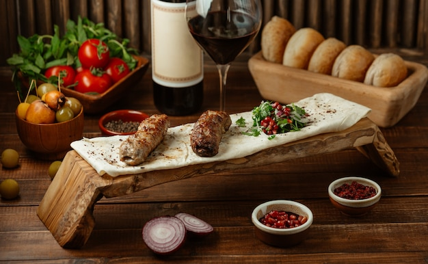 Two pieces of lule kebab bbq served with species and herbs Free Photo