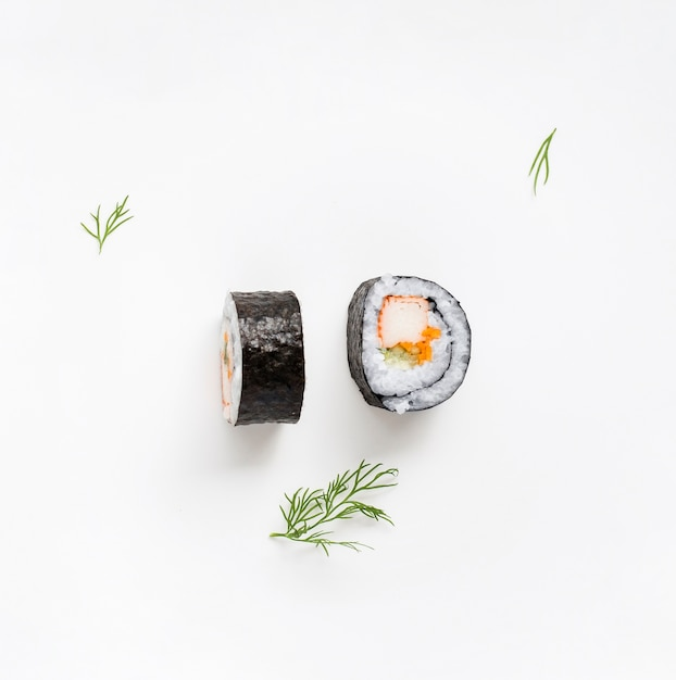 Two pieces of maki sushi rolls Free Photo