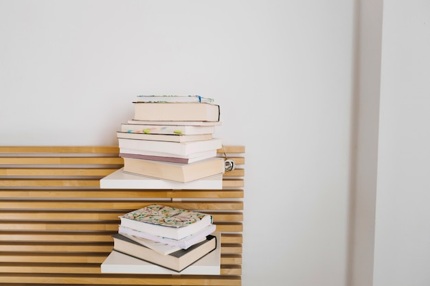 Two piles of books and notebooks Free Photo