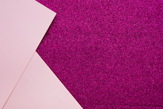 Two pink cardboard papers on purple backdrop Free Photo