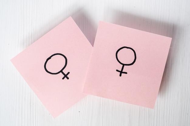 Two pink stickers with gender symbols venus on white background Premium Photo