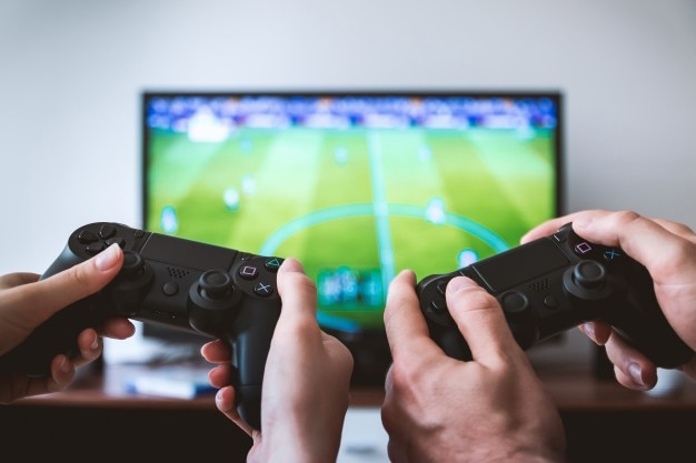 Two players playing video games on tv at home 447 19326886