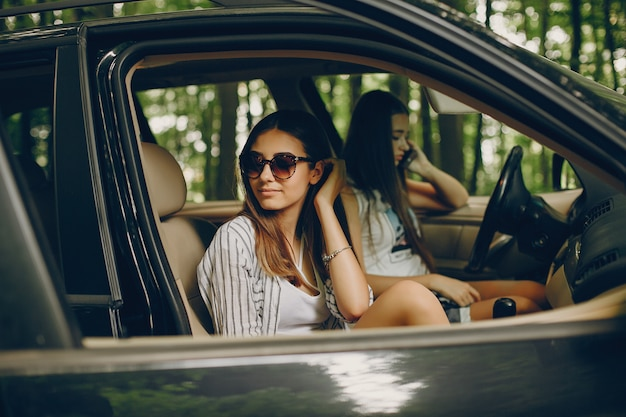 Two pretty girls in a car Free Photo