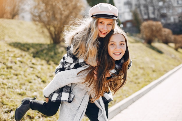 Two pretty girls in a spring park Free Photo