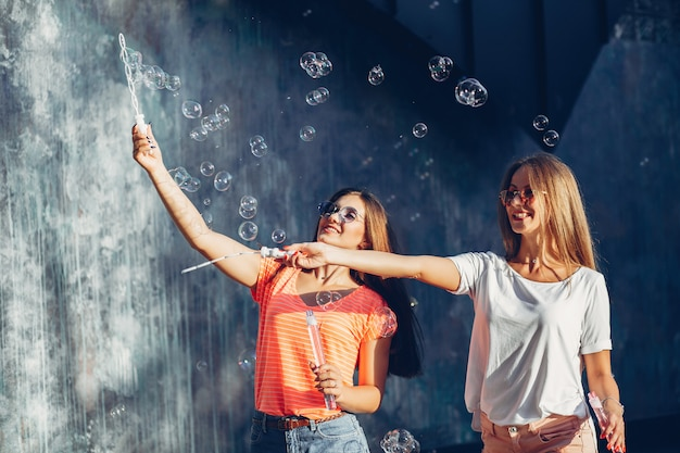 Two pretty girls in a summer city Free Photo