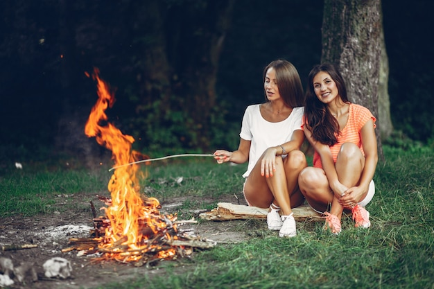 Two pretty girls in a summer park Free Photo