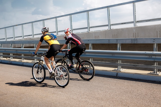 Two professional cyclists taking a training ride Premium Photo