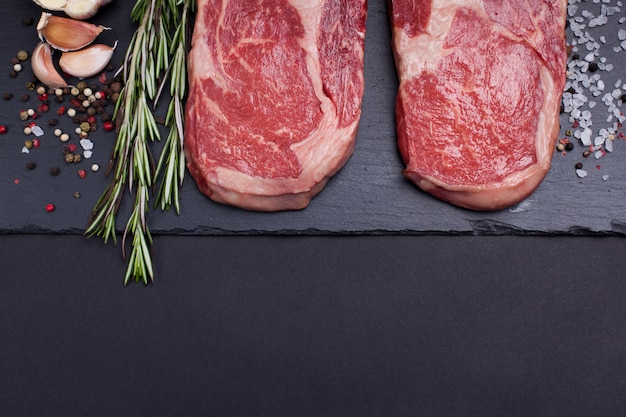 Two raw marble meat, black angus ribeye steak. Premium Photo