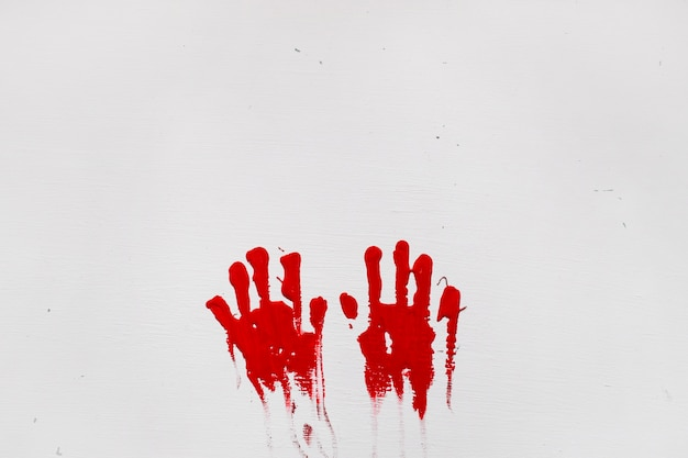 Two red handprints Free Photo