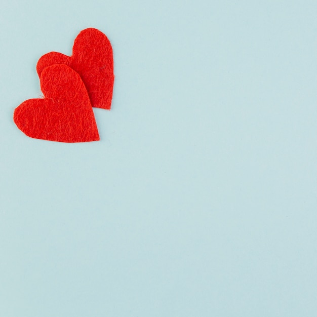 Two red hearts in upper corner Free Photo