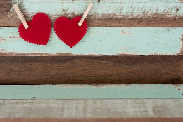 Two red hearts with wood clip Free Photo