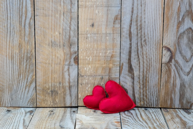 Two red hearts on a wooden background for valentine's day Premium Photo