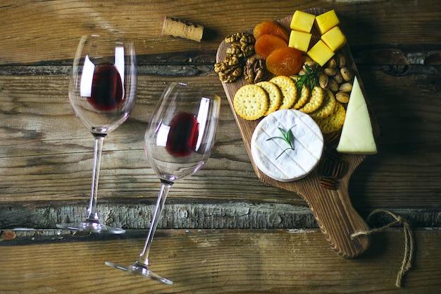 Two red wine glass and cheese platter top view Free Photo